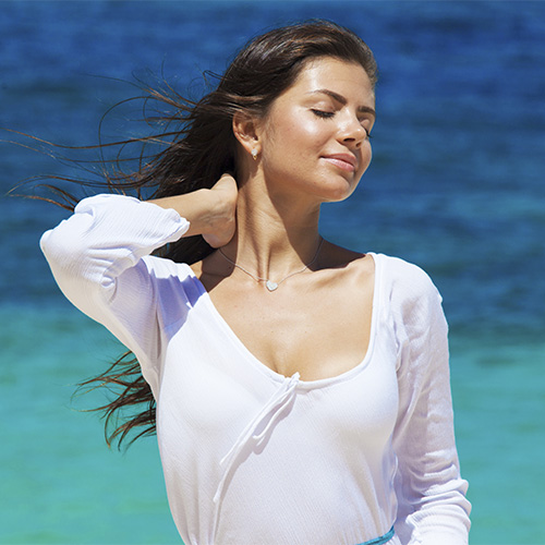 woman with smooth neck and face in white dress with deep neckline